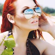 Beautiful red-haired woman in sunglasses Stock Photos