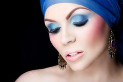 Beautiful woman in a lovely colorful makeup - stock photo
