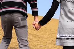 Hand-in-hand. couple love in autumn scenery Stock Photos