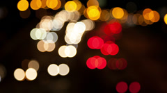 Defocused car lights moving in night time Stock Footage