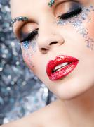 Face of a beautiful woman in a fancy makeup up close - stock photo