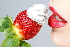 Beautiful red lips and tasty strawberry whipped cream Stock Photos