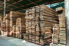 Stack of pile wood bar in lumber yard factory use for construction wood indus Stock Photos