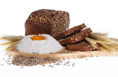 Rye bread, flour, eggs, corn ears Stock Photos