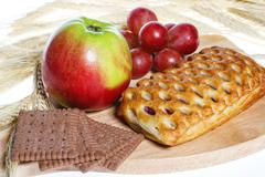 Vegetarian breakfast - cookies and fruits Stock Photos