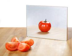Tomato in mirror image,abstract vision Stock Photos