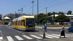 Tram in Belém Lisbon , people Crossing the Road Stock Footage