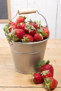 strawberries in a small metallic bucket - stock photo