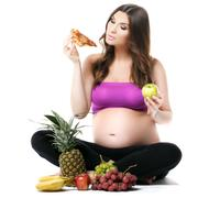 Pregnant woman, fruit and pizza, healthy eating - stock photo