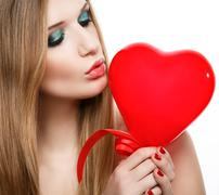 Valentine's Day.Beautiful blonde kissing heart Stock Photos