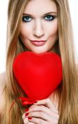 Beautiful smiling blonde girl with heart in hands Stock Photos