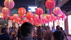 Hong Kong Lunar Chinese New Year Spring Festival red lanterns attract tourists - stock footage