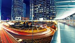 modern urban city with freeway traffic at night, hong kong - stock photo