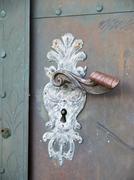 Historical doorhandle - stock photo