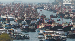 Time Lapse  Chinese fishing boats shelter between Apliu Chau and Aberdeen harbor Stock Footage