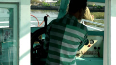 India Kerala Kochi Cochin City 057 backwaters boating, helmsman on the bridge Stock Footage