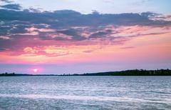 Beautiful sunset over the lake Stock Photos