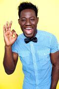 Joyful guy showing excellent gesture - stock photo
