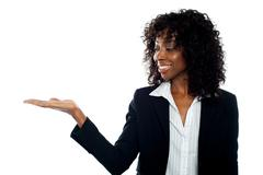 African woman with open palm. Copy space - stock photo