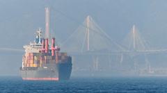 Handheld Hong Kong Cargo container ship against Tsing Yi bridge China Asia Stock Footage