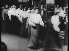 Women Clocking Out Of Work At Factory- Circa 1900 Stock Footage