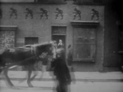 Horse Drawn Street Car Passing By  circa 1908 - stock footage