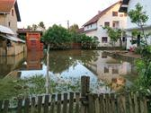 Stock Photo of condition of house with a yard after floods