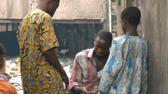 Money changes hands in slum. Stock Footage