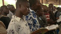 Congregation singing in Nigerian mega church Stock Footage
