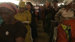 Women singing in Nigerian mega church Stock Footage