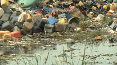 Putrid water, waste mountain, human scavengers - stock footage