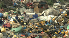 Hand-sorting Lagos' filth - stock footage