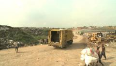 Waste truck arrives at Lagos dump Stock Footage