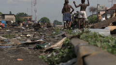 Rail tracks disappear under slum encroachment Stock Footage