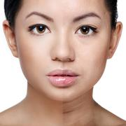 Face of beautiful young woman before and after retouch Stock Photos