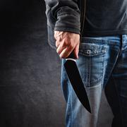 Evil man hold shiny knife, killer in action Stock Photos