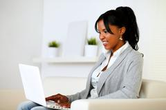 Afro-american woman using laptop - stock photo