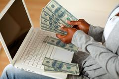 Black woman counting plenty of cash money - stock photo