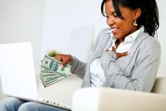 Ambitious excited young woman with money - stock photo
