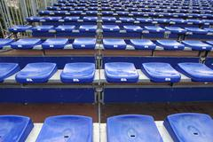 Many blue and yellow vip seat in football stadium Stock Photos