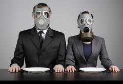 Couple at gas masks - stock photo