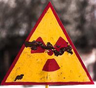 Radioactivity symbol on blurry background - stock photo