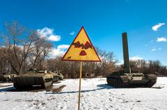 War machines with radioactivity sign at Chernobyl - stock photo