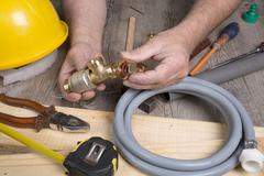 plumbing do-it-yourself with different tools - stock photo