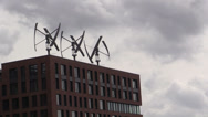 Stock Video Footage of Wind turbines on the roof of a building