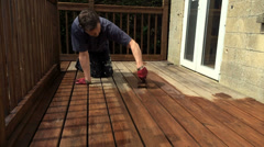 Varnishing oiling protecting decking Stock Footage