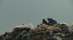 Men on waste mountain Stock Footage