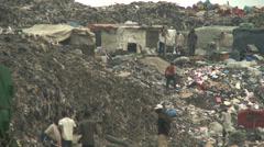 Shanty homes on garbage mountain, Lagos Stock Footage