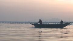 Boats  in sunset light on Makoko lagoon Stock Footage