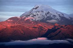 Sunset on the mighty volcano cayambe in ecuador Stock Photos